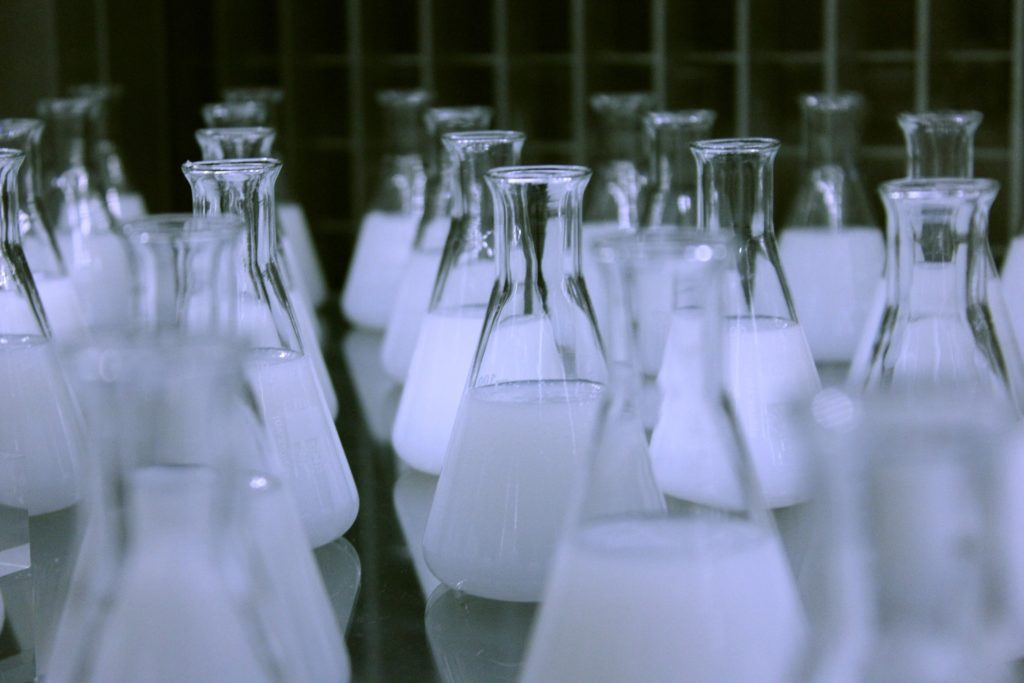 flasks contenting white liquid